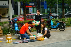 Shenzhen, China: on the sidewalk courier company employees are distributing customer courier Royalty Free Stock Photography