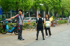 Shenzhen, China: on the sidewalk courier company employees are distributing customer courier Stock Photos