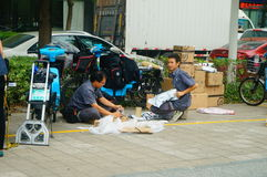 Shenzhen, China: on the sidewalk courier company employees are distributing customer courier Royalty Free Stock Image