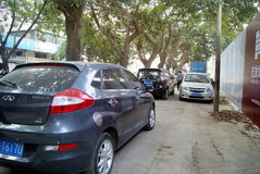 Shenzhen, china: sidewalk disorderly park vehicles Stock Photo