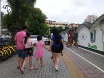 Shenzhen, China: sidewalk, the family walked by Royalty Free Stock Photos