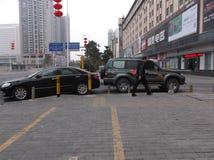 Shenzhen, China: sidewalk illegal park car Royalty Free Stock Image