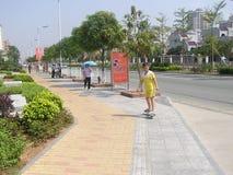 Shenzhen, China: skateboarding boy Stock Images