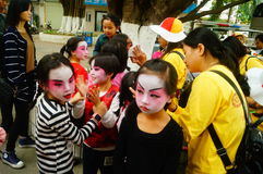 Shenzhen, China: small performers, after the show in the rest or remover. Xixiang temple fair activities, to participate in the parade of small actors, at the Stock Image