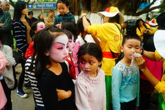 Shenzhen, China: small performers, after the show in the rest or remover. Xixiang temple fair activities, to participate in the parade of small actors, at the Stock Photos