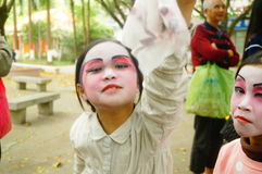 Shenzhen, China: small performers, after the show in the rest or remover Stock Images