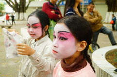 Shenzhen, China: small performers, after the show in the rest or remover. Xixiang temple fair activities, to participate in the parade of small actors, at the Royalty Free Stock Image