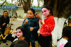 Shenzhen, China: small performers, after the show in the rest or remover. Xixiang temple fair activities, to participate in the parade of small actors, at the Stock Photography