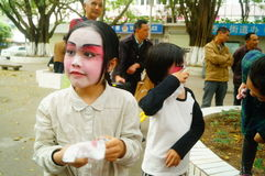 Shenzhen, China: small performers, after the show in the rest or remover. Xixiang temple fair activities, to participate in the parade of small actors, at the Royalty Free Stock Images