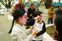 Shenzhen, China: small performers, after the show in the rest or remover Stock Image