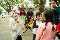 Shenzhen, China: small performers, after the show in the rest or remover. Xixiang temple fair activities, to participate in the parade of small actors, at the Stock Images