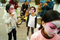 Shenzhen, China: small performers, after the show in the rest or remover. Xixiang temple fair activities, to participate in the parade of small actors, at the Royalty Free Stock Photography