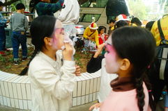Shenzhen, China: small performers, after the show in the rest or remover. Xixiang temple fair activities, to participate in the parade of small actors, at the Royalty Free Stock Photo