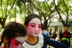 Shenzhen, China: small performers, after the show in the rest or remover. Xixiang temple fair activities, to participate in the parade of small actors, at the Stock Photo