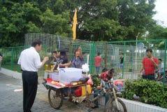 Shenzhen, China: small roadside vendors Royalty Free Stock Photos