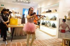 Shenzhen, China: store promotions, the woman playing the violin. Xixiang Shenzhen Tianhong shopping malls, store promotions, a young woman playing the violin to Stock Photography