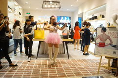 Shenzhen, China: store promotions, the woman playing the violin. Xixiang Shenzhen Tianhong shopping malls, store promotions, a young woman playing the violin to Royalty Free Stock Images