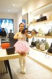 Shenzhen, China: store promotions, the woman playing the violin. Xixiang Shenzhen Tianhong shopping malls, store promotions, a young woman playing the violin to Royalty Free Stock Image