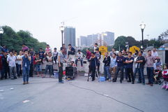 Shenzhen, China: street performances to beg Stock Image