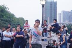 Shenzhen, China: street performances to beg Royalty Free Stock Images