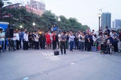 Shenzhen, China: street performances to beg Stock Photo