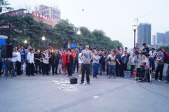 Shenzhen, China: street performances to beg Stock Photos