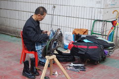 Shenzhen, China: street shoe stall Stock Images