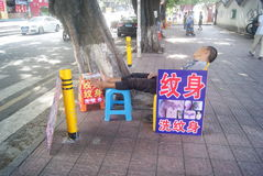 Shenzhen, China: street vendors sleep Royalty Free Stock Images