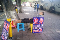Shenzhen, China: street vendors sleep Royalty Free Stock Image