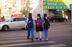 Shenzhen, China: students cross traffic junctions Royalty Free Stock Image