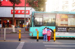 Shenzhen, China: students cross traffic junctions Stock Photo