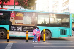 Shenzhen, China: students cross traffic junctions Stock Photography