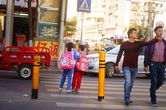 Shenzhen, China: students cross traffic junctions Royalty Free Stock Images