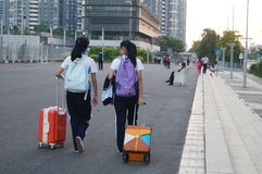 Shenzhen, China: students go on the way to school Stock Photos