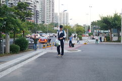 Shenzhen, China: students go on the way to school Stock Photo