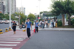 Shenzhen, China: students go on the way to school Royalty Free Stock Image