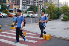 Shenzhen, China: students go on the way to school Royalty Free Stock Images