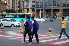 Shenzhen, China: students go on the way to school Royalty Free Stock Photo