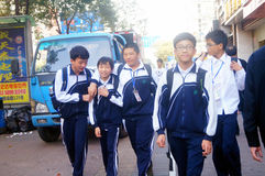 Shenzhen, China: students walk home after school Royalty Free Stock Images