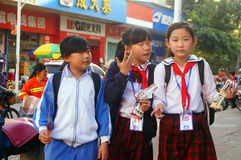 Shenzhen, China: students walk home after school Stock Image