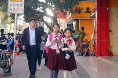 Shenzhen, China: students walk home after school Stock Images