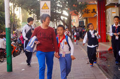 Shenzhen, China: students walk home after school Royalty Free Stock Image