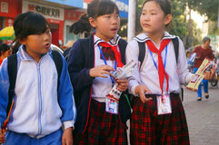 Shenzhen, China: students walk home after school Royalty Free Stock Photo