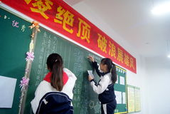 Shenzhen, china: students in writing the blackboard newspaper Stock Photo