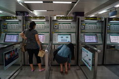 Shenzhen, China: subway station to buy tickets to women Stock Photo