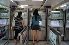 Shenzhen, China: subway station to buy tickets to women Stock Photos
