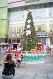 Shenzhen, china: taking pictures in front of a christmas tree Stock Photos