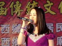 Shenzhen, China: temple fair entertainment, women singing Stock Photography