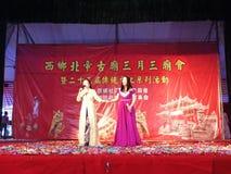 Shenzhen, China: temple fair entertainment, women singing Royalty Free Stock Photos