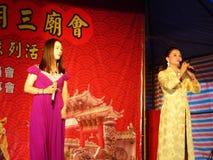 Shenzhen, China: temple fair entertainment, women singing Stock Photos